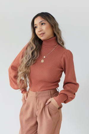 wild rina wildrina.com turtle neck balloon sleeve statement shoulder brick red maroon terracotta knit ribbed long sleeve sweater