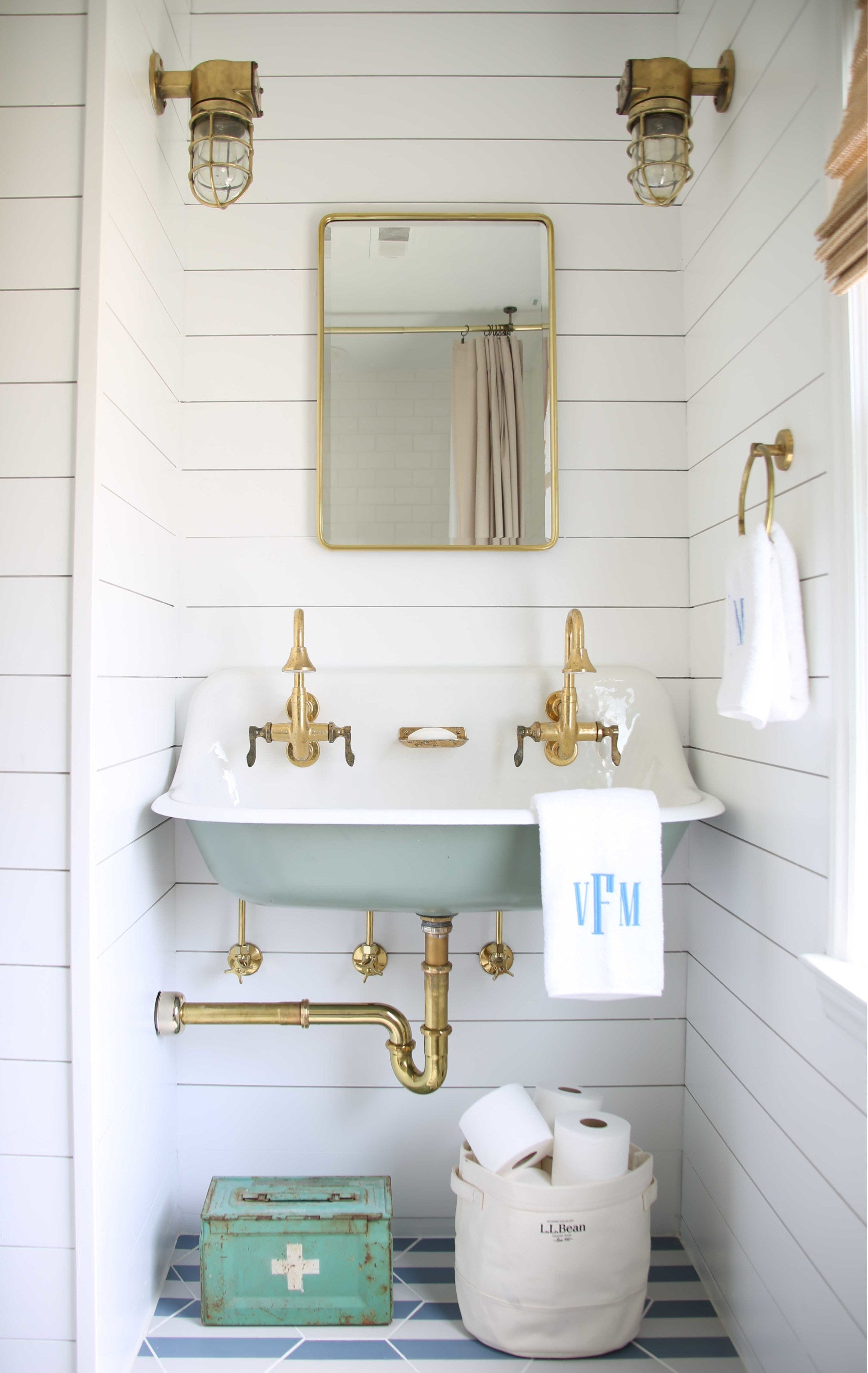 The perfect small bathroom remodel idea? Add shiplap to your walls, paint it white with Clare's Fresh Kicks, and finish it off with a vintage nautical-inspired sink.