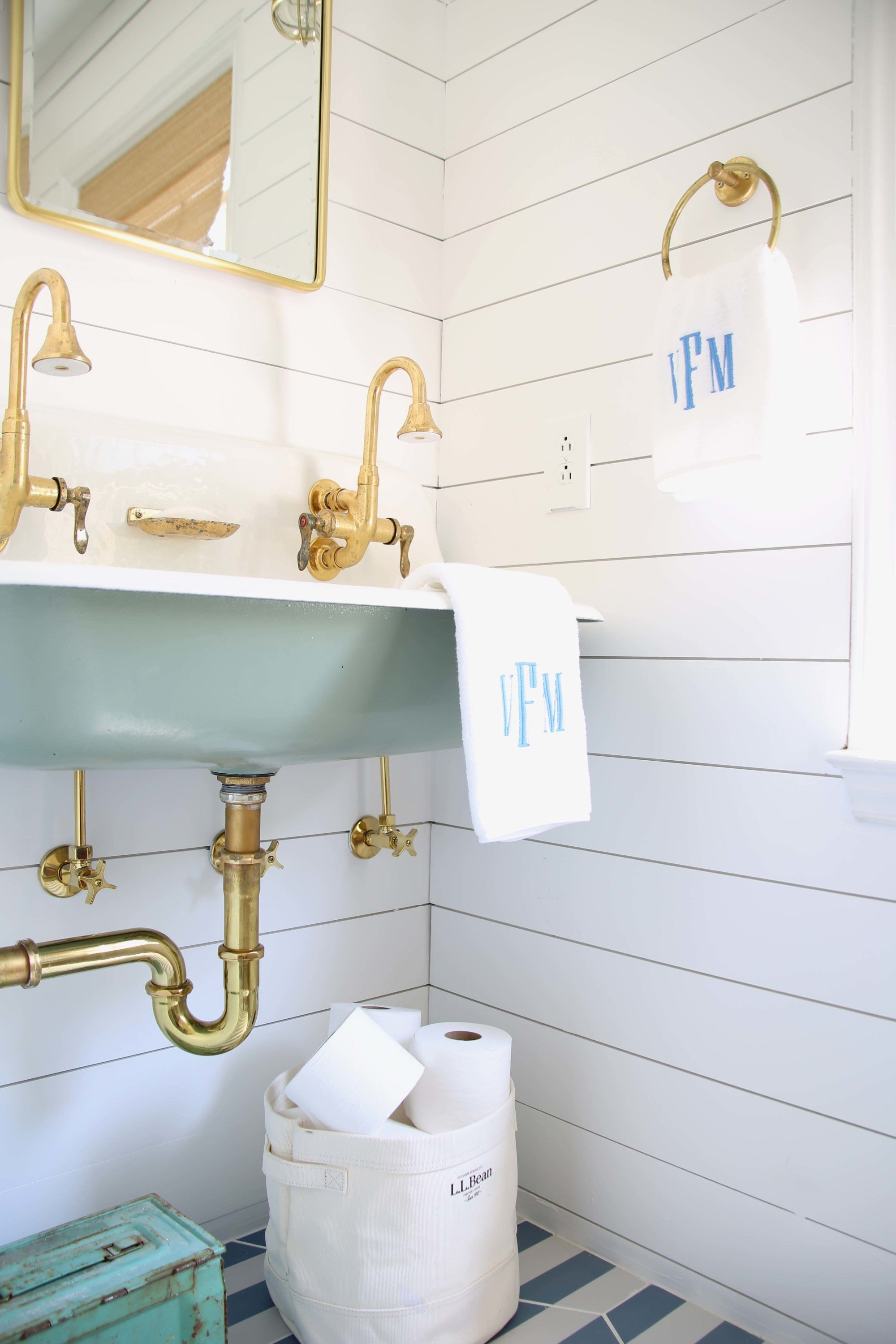 This vintage Kohler Brockway sink was painted with a coat of airy blue-green for a nautical vibe. Get the look with a coat of Clare's Headspace and painted shiplap using Fresh Kicks.
