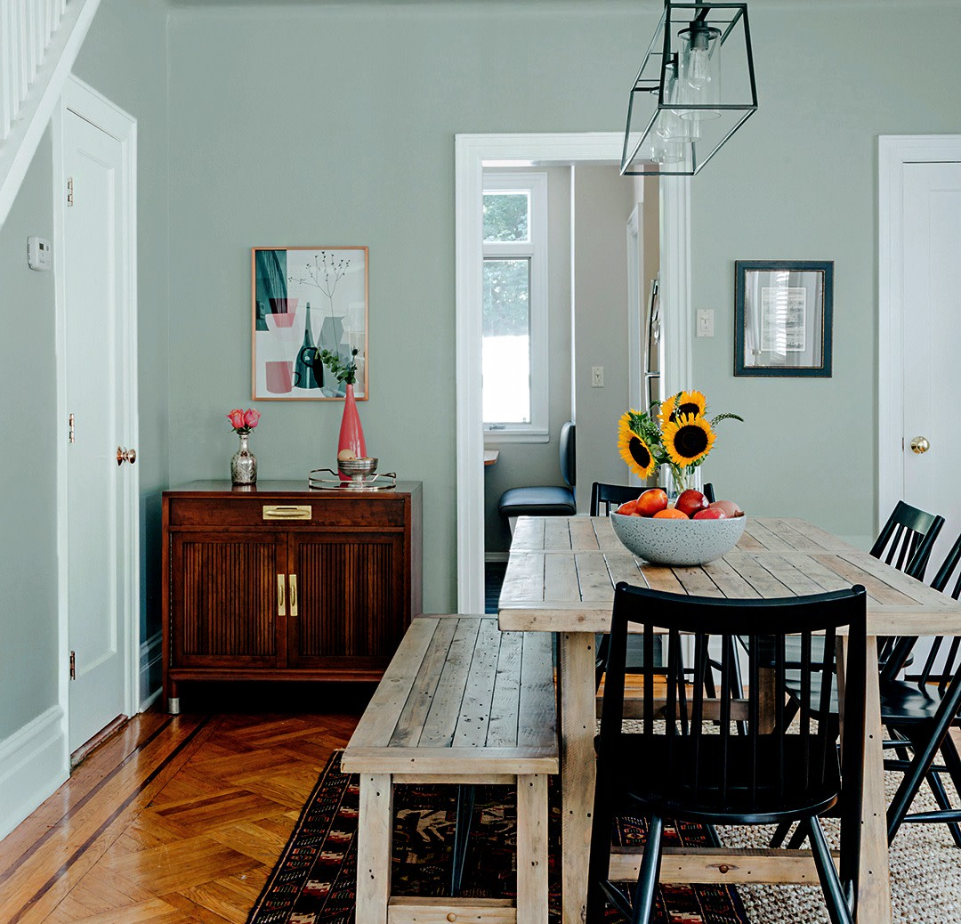 @brooklinteriors updated a dining room with a soft, greenish gray paint.