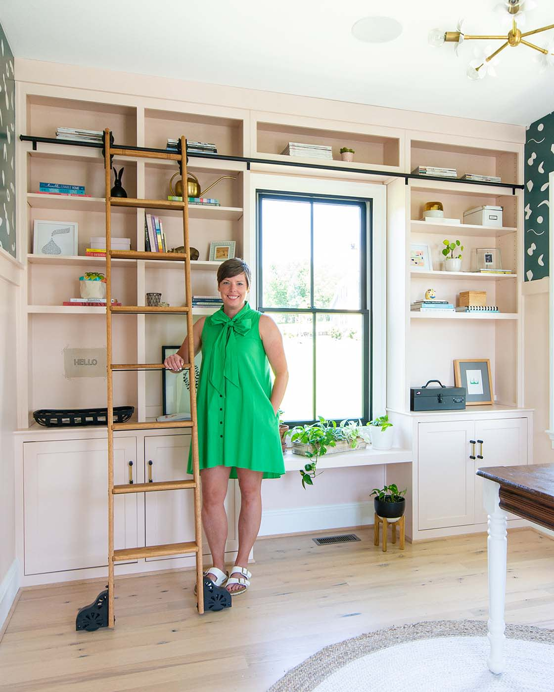 What is your favorite element in the room? Attaching a rolling library ladder to the built-in wall was a splurge and feels like a bit of a luxury but I must say, I can't imagine the space without it. The ladder adds another wood element to the space and is like the crowning jewel of the project.  Any decor tips you'd like to share? If you have existing traditional furnishings, make more modern choices with your wall coverings, hardware, and light fixtures. Pairing my Great Grandmother's table with an unexpected paint color and bold wallpaper feels like the best kind of modern mixing.