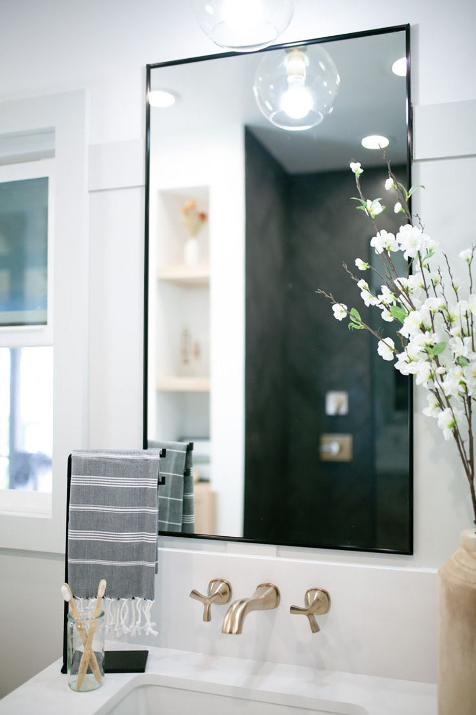 You'd never guess this luxe bathroom was once dark and dated. Go inside the bathroom remodel before and after now!