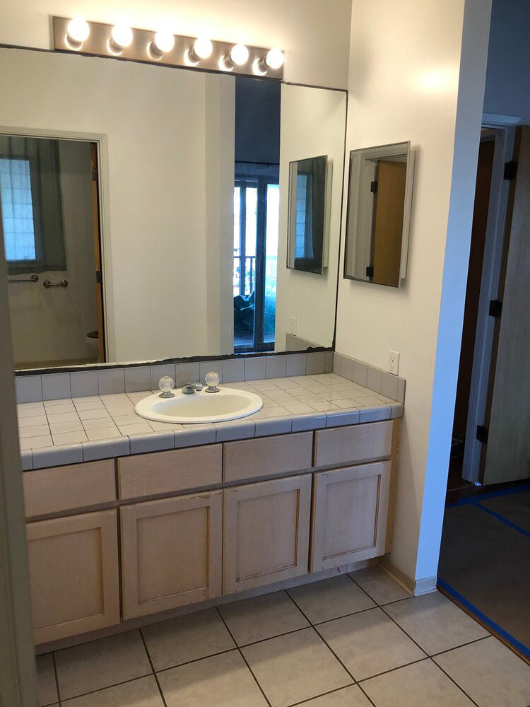 """You have to see this bathroom remodel before and after. This photo shows a glimpse into the dated """"before."""" Read more to see the after!"""