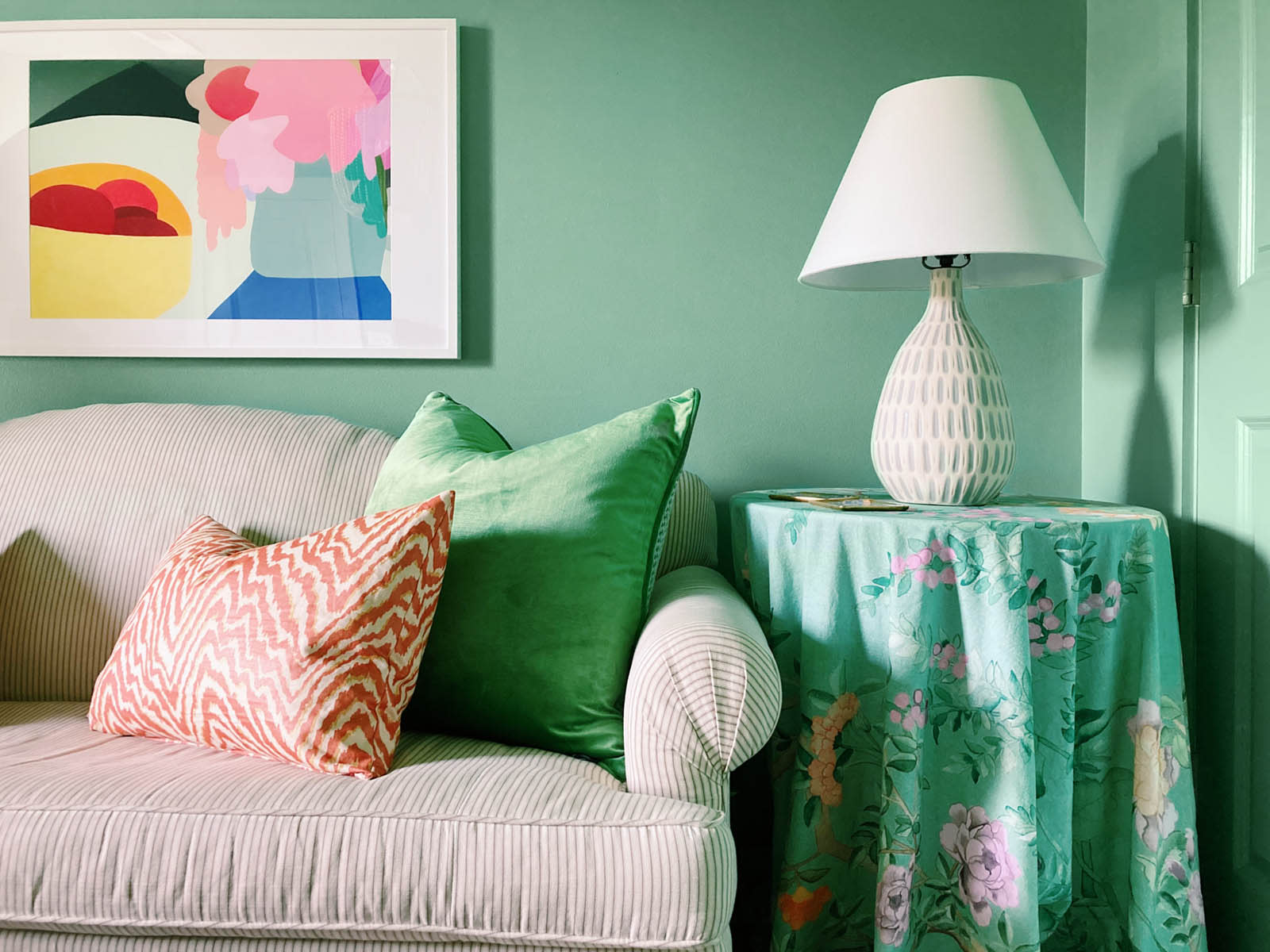 This guest bedroom packs a serious punch — and it's functional for the whole family to enjoy! The paint color is OMGreen by Clare.