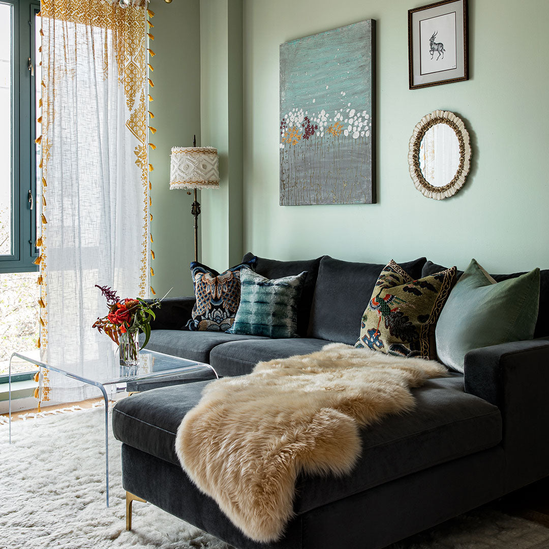 A sophisticated living room with an olive green wall.