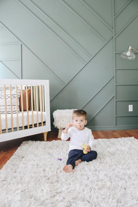 A green accent wall. This accent wall idea is perfect for a kids room. Green wall paint color is Current Mood by Clare Paint