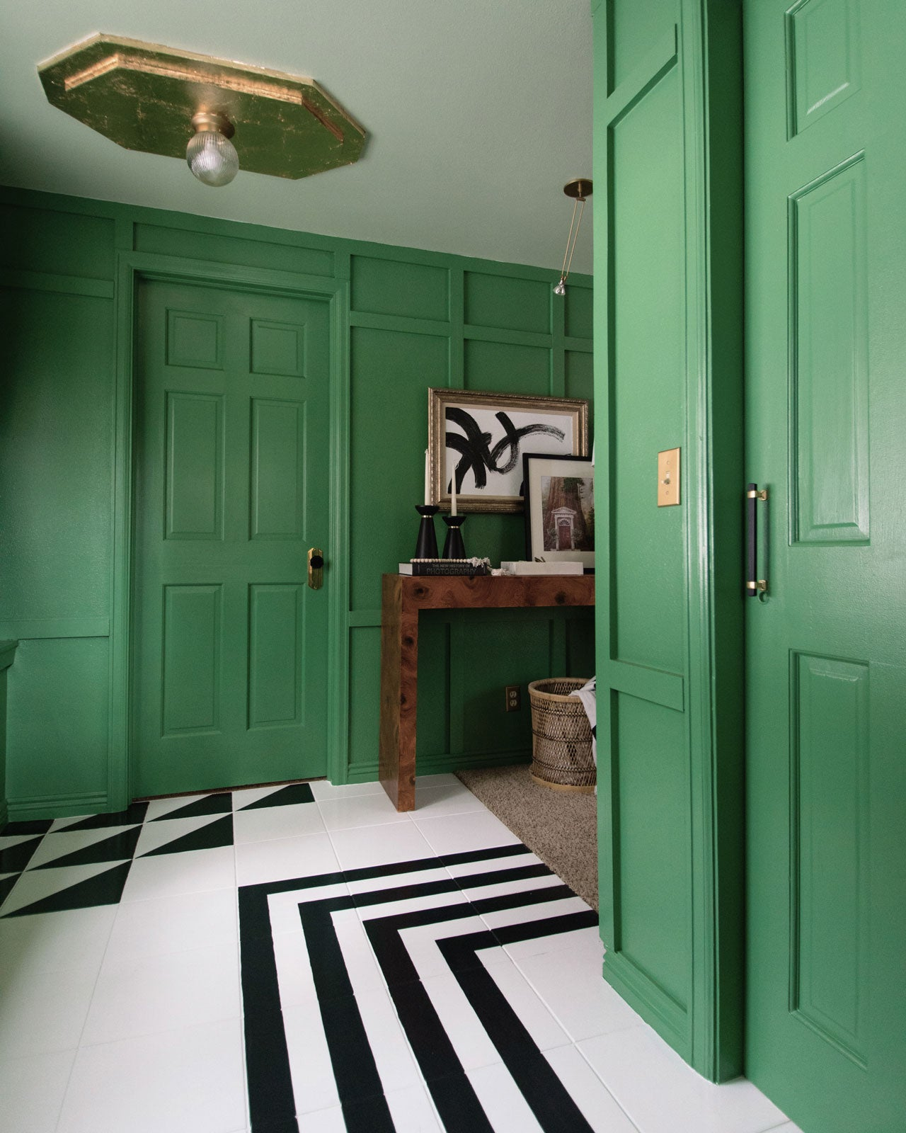 A Matcha green entryway painted in Matcha Latte by Clare. Get inspired with stylish entryway ideas to make a bold statement and welcome guests in style!