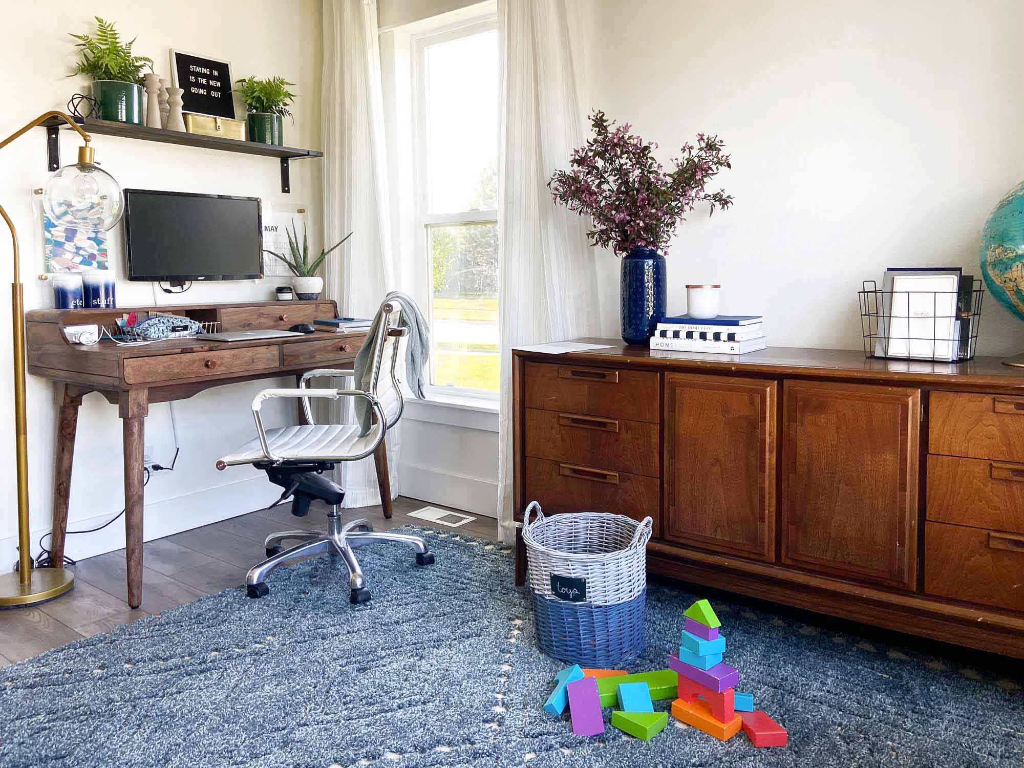 A home office doesn't need to feel separate and sterile, this inspiring home office shows how you can work and play surrounded by your family.