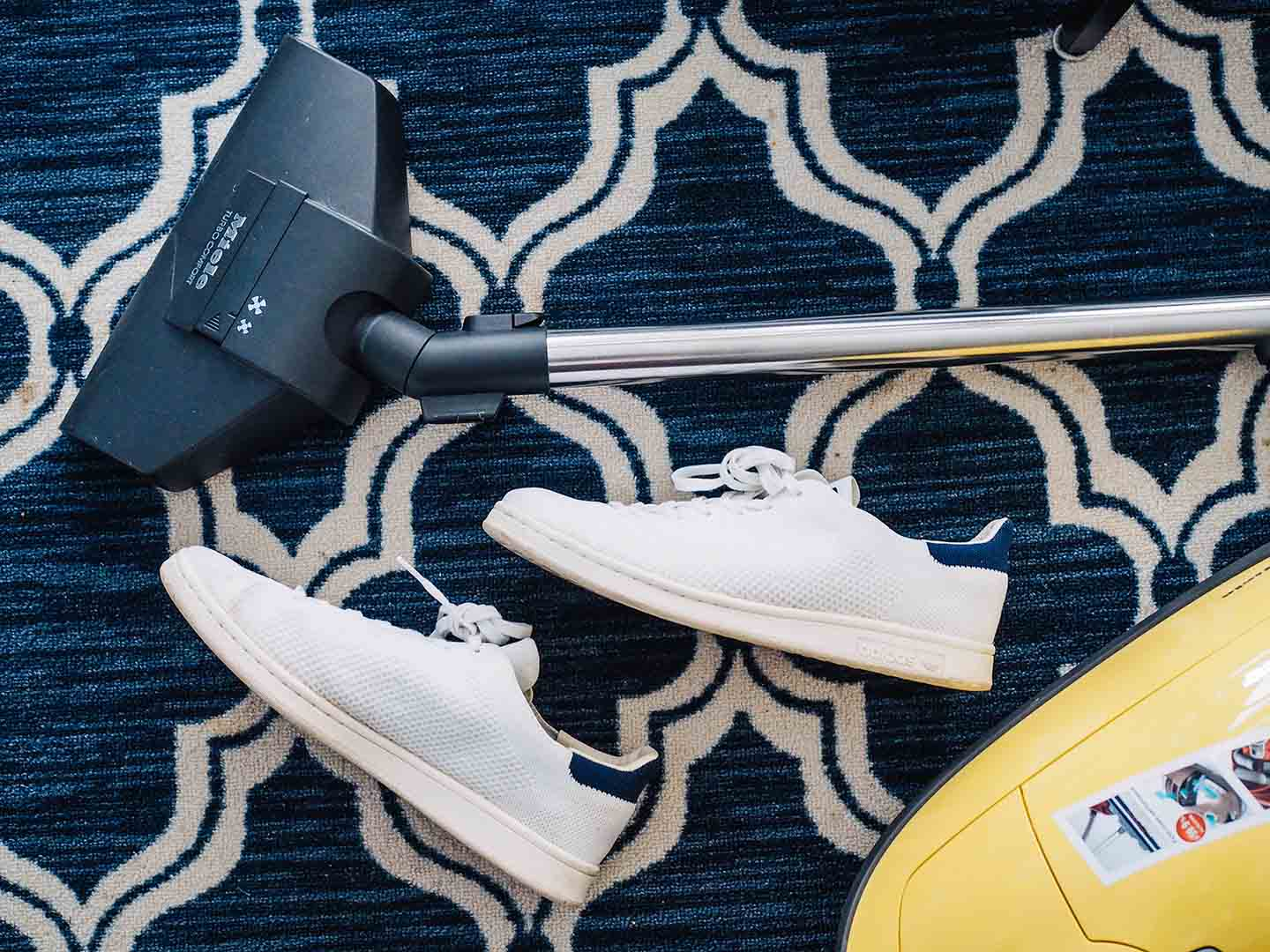 healthier home vacuum and shoes on blue carpet