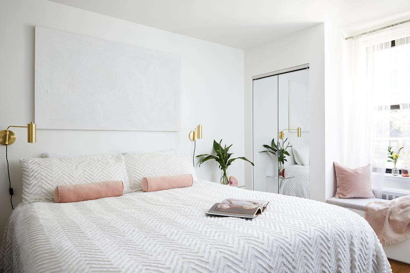 This stylish all-white bedroom makeover combines little luxuries and minimalist decor to create the ultimate bedroom retreat. See inside this dreamy space.