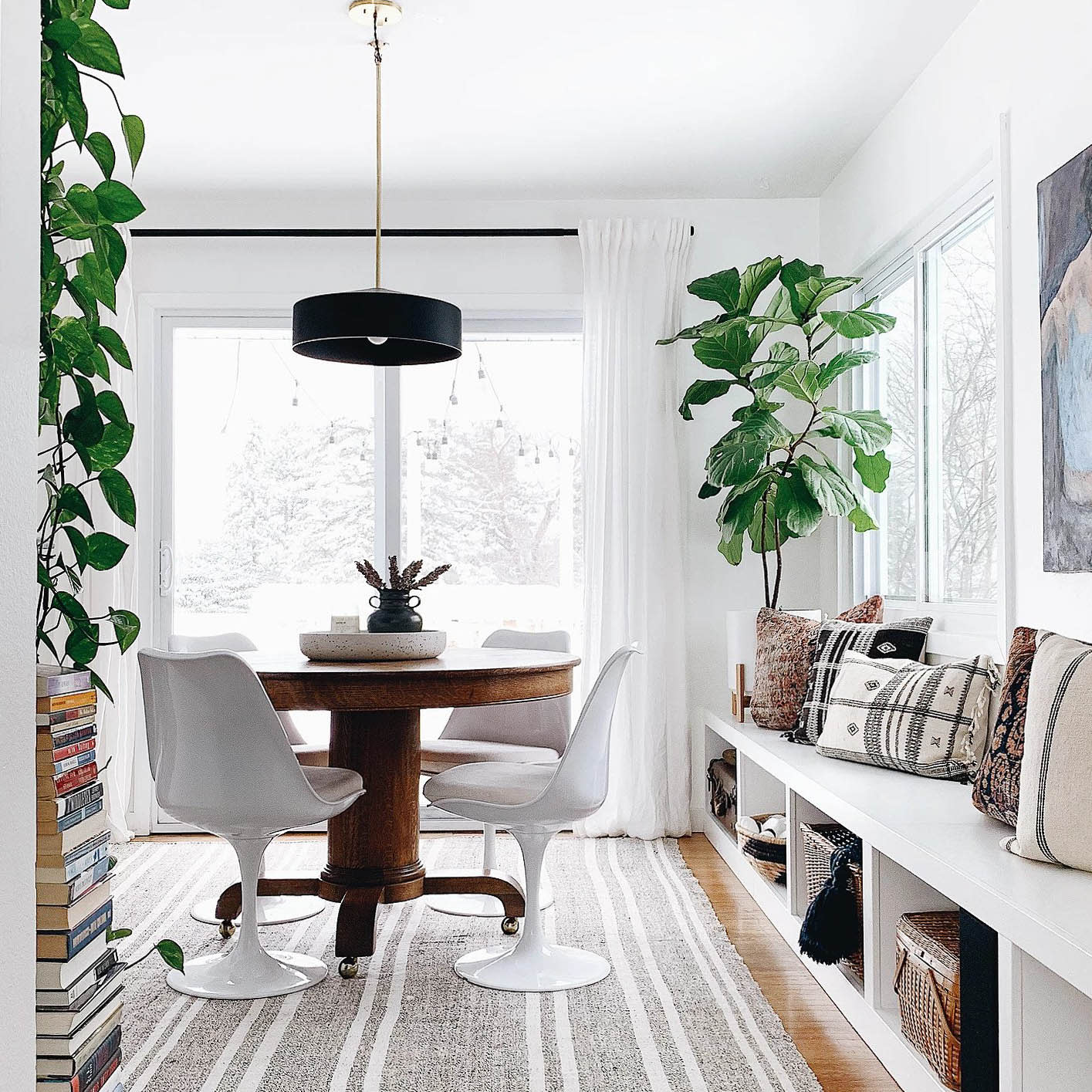 A bold door pained in Blackest by Clare is the perfect contrast for all-white walls. This stunning home is a lesson in how to make shades of white paint work in every room in your home.