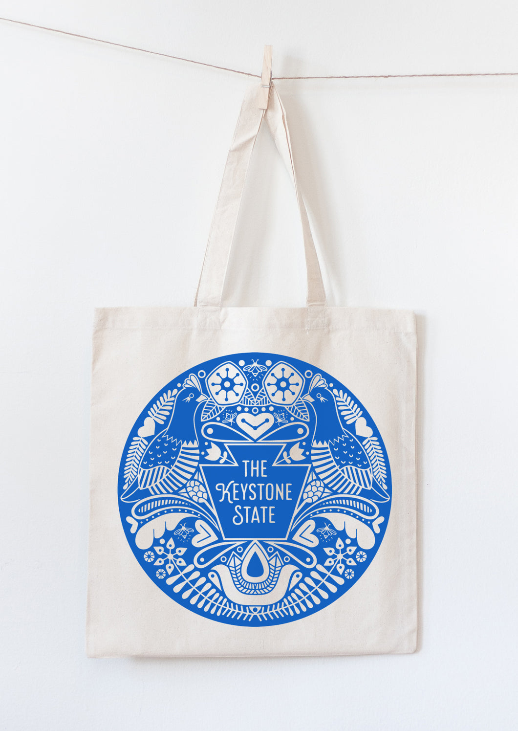 The Keystone State tote bag mockup with Pennsylvania state symbols