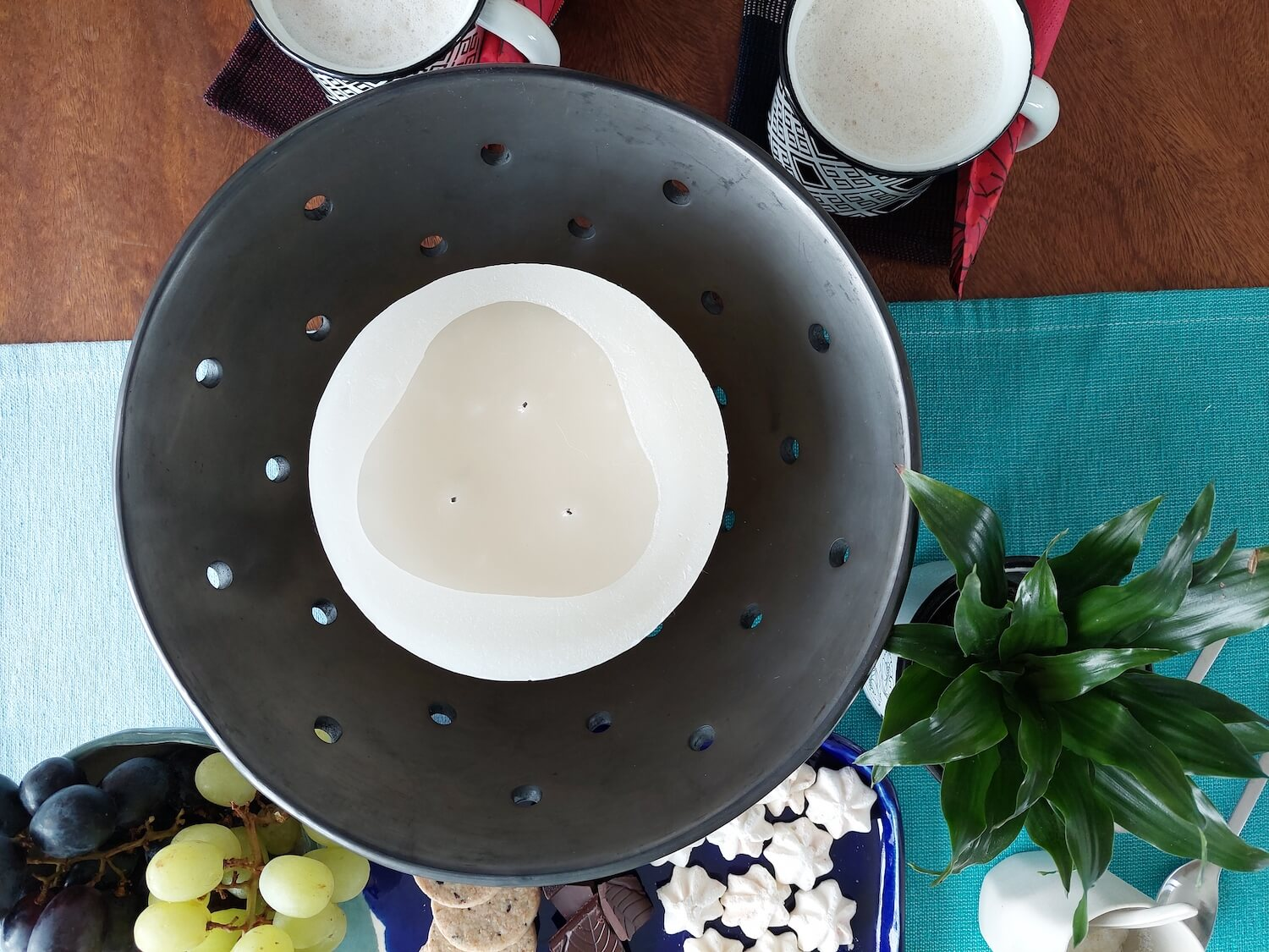 Black clay candle holder as coffee table center piece