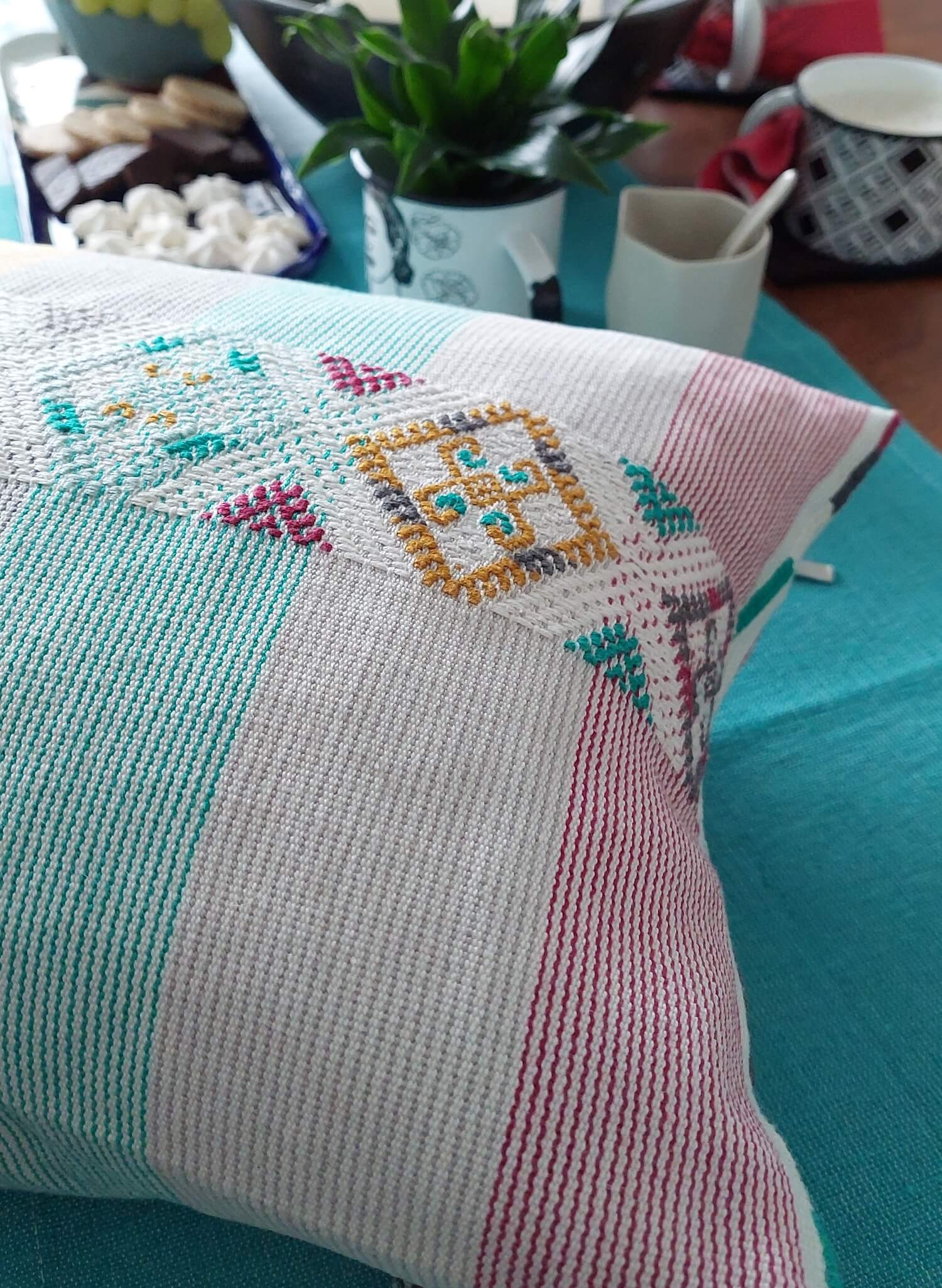 Modern mexican Colorindio pillow aqua and red that matches the coffee table