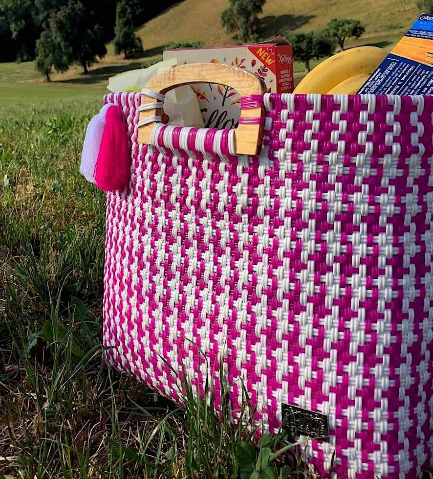 Pink shopper bag for groceries handwoven with recycled plastic