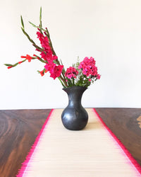 Bartolo flower vase on table with pink flowers