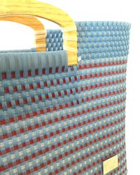 I-XU Wood Handle Tote bag in light blue with red detail view