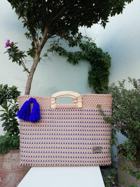 I-XU Wood Handle Tote bag in pink with blue details outdoor