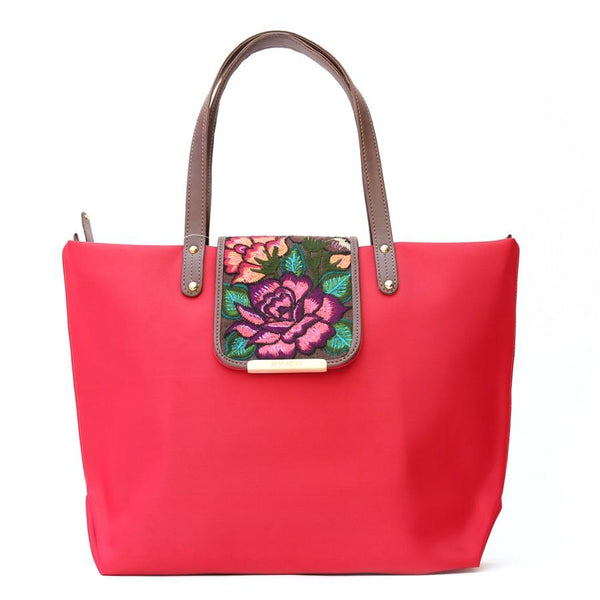 Front view of Camelia red bag with handmade flower embroidery