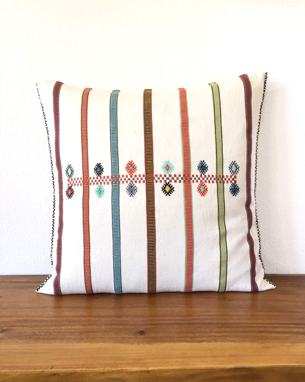 Martha Marco Throw Pillow with colorful stripes and brocades front view