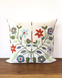 Mica Cenote Throw Pillow with embroidered flowers front view