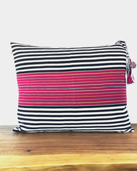 Nachig Lupe Throw Pillow black and white horizontal stripes with pink accent in middle back view