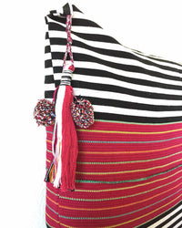 Nachig Lupe Throw Pillow black and white horizontal stripes with pink accent in middle detail view of tassel