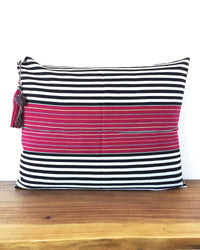 Nachig Lupe Throw Pillow black and white horizontal stripes with pink accent in middle front view