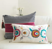 Set of two decortive Pillows with hand embroidered flowers and stripes
