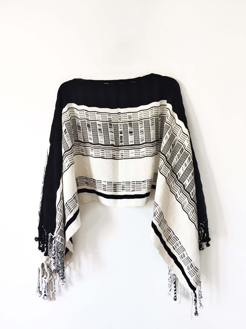 products/Taabal_Black_White_Poncho_side_position.JPG