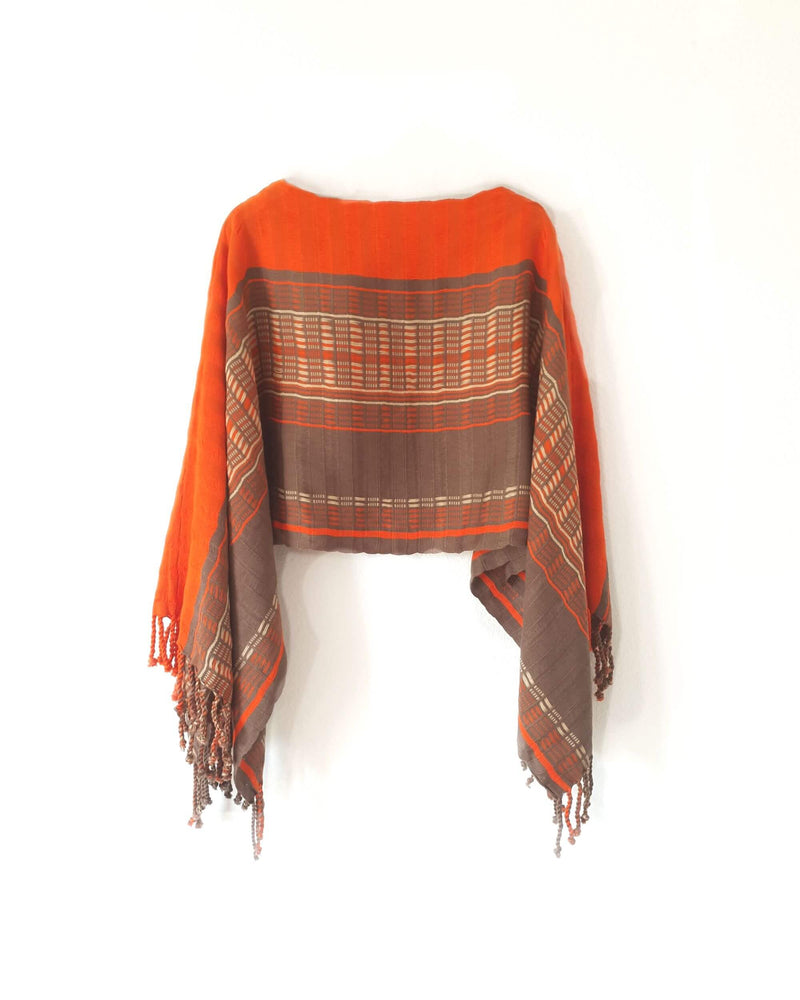 products/Taabal_Brown_Orange_Poncho_-_side_view.jpeg