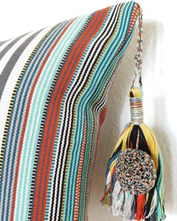 Decortive Pillow with grey & white stripes detail view of tassel