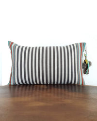 Decortive Pillow with grey & white stripes and a decorative tassel