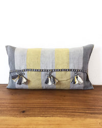 Universo Lalo Throw Pillow grey tones and a touch of yellow back view of ribbons