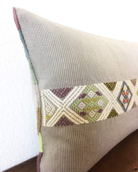 Universo Luna Throw Pillow light grey with brocades in pastel colors detail view of brocades
