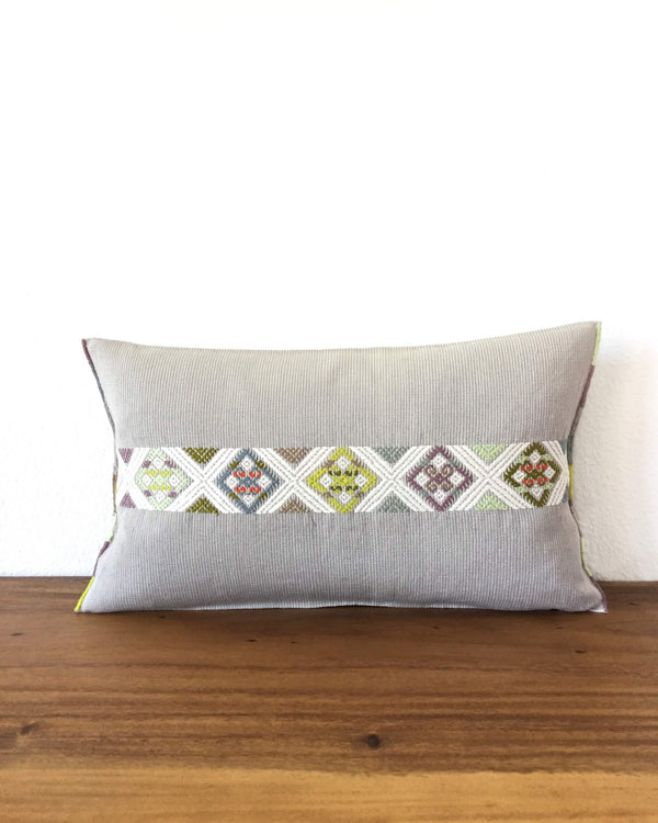 Universo Luna Throw Pillow light grey with brocades in pastel colors front view