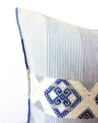 Universo Pulmo Throw Pillow light blue and grey tones with brocades in pastel colors detail view of brocades