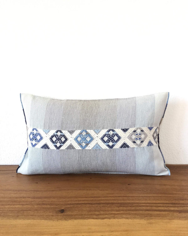 Universo Pulmo Throw Pillow light blue and grey tones with brocades in pastel colors front view