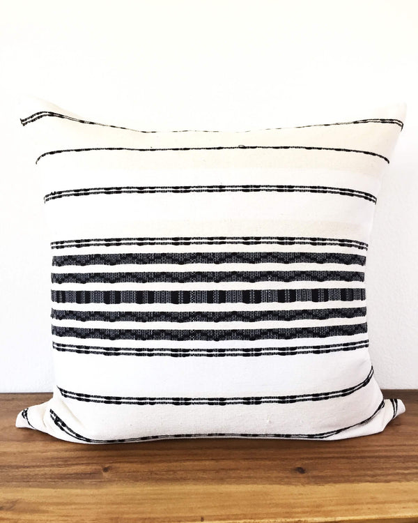 Zipolite Throw Pillow wite with black brocade stripes front view