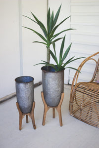 Set of 2 Galvanized Urns On Wood Bases #1