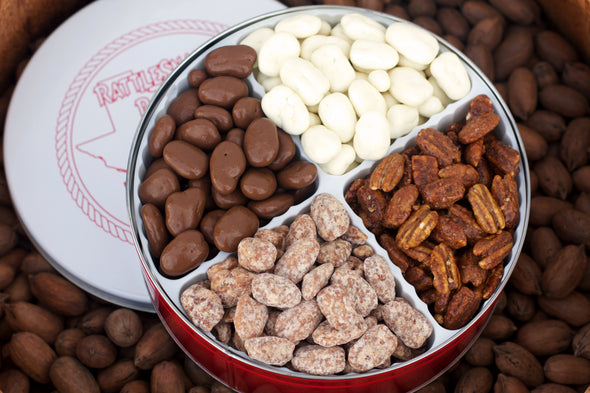Our 4 Way Pecan Gift Tin includes four of our most popular candied pecan flavors! Milk Chocolate Pecans, White Chocolate Pecans, Honey Toasted Pecans and Praline Pecans! This tin includes 3.5 pounds of candied pecans.