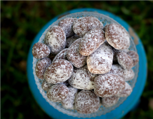 These are our golden pecans coated in toffee, milk chocolate and white powder sugar. Enjoy these yourself or send out as a gift!