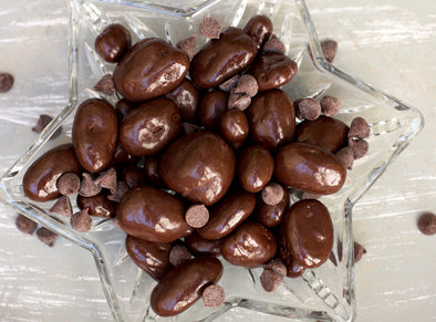 Golden pecan halves drenched in deep dark chocolate. Enjoy them yourself or send them out as a gift! Sold in 1 pound bags for $15.99.
