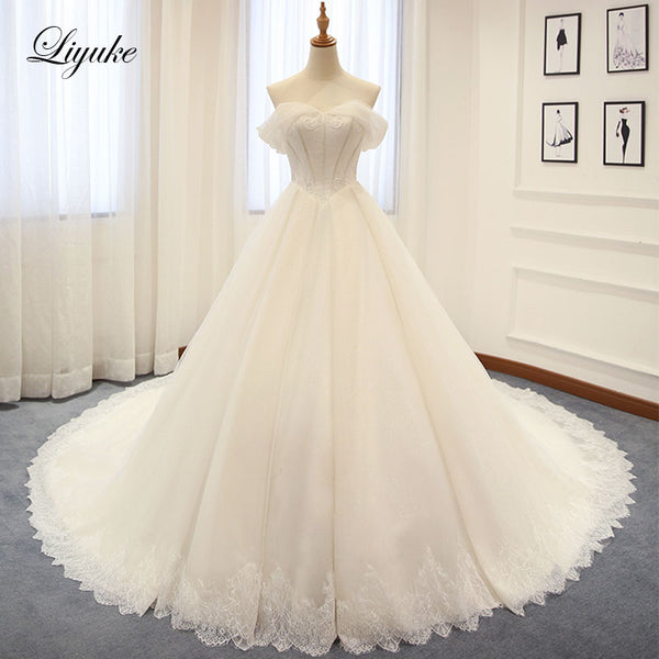 Luxurious Silky Tulle Off The Shoulder Ball Gown Wedding Dress Applique Beading Court Train Bridal