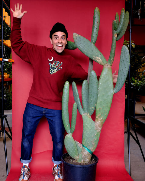 Tula co-founder Ivan Martinez stands next to a giant spineless Opuntia cactus, for sale at Tula Plants & Design.