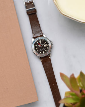 rolex GMT master 1675 with brown watch strap