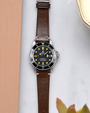 rolex submariner with brown leather watch strap