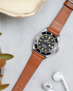 rolex submariner with light brown watch strap