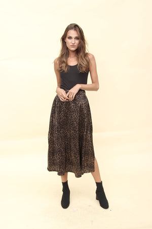 Aroma Couture Ropa Pleated foiled animal print midi skirt.
