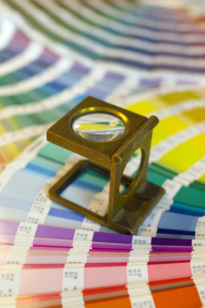 paint colour swatches with magnifying glass